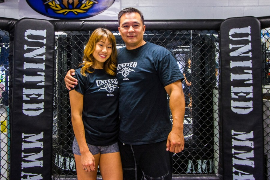 """It's always hard. Before I'm a coach, I'm a dad."" - Ken Lee. ""He is very traditional in the values he teaches me, and it's just to be a good person."" - Angela Lee"